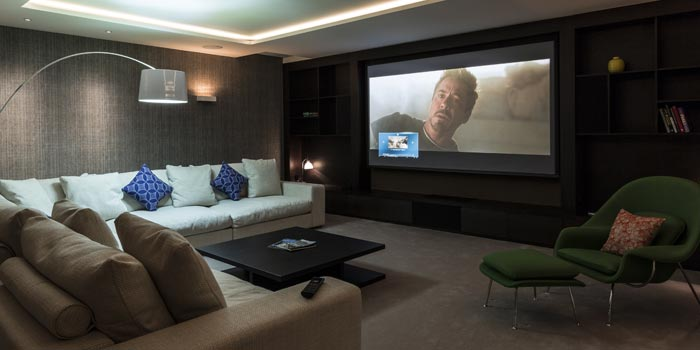 Lounge with large television displaying a movie