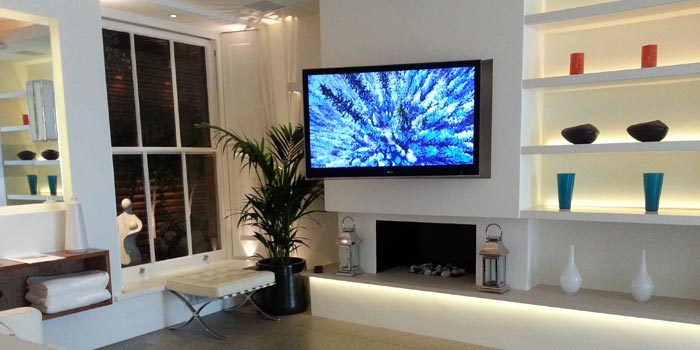 TV mounted on the wall in a lounge