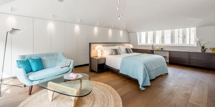 Well lit, open plan bedroom at day time