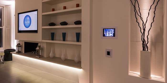 Lighting controls mounted on the wall in a modern lounge